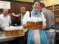 lady holding beer jugs